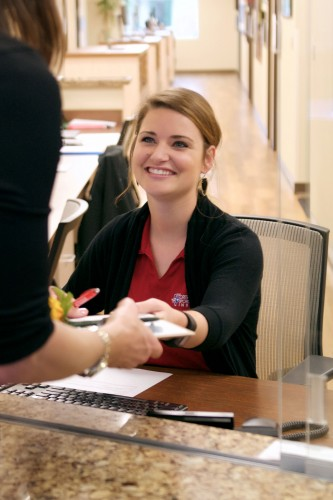 Receptionist greeting a patient at OSMI