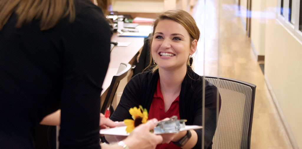 osmi-greeting-at-reception-desk
